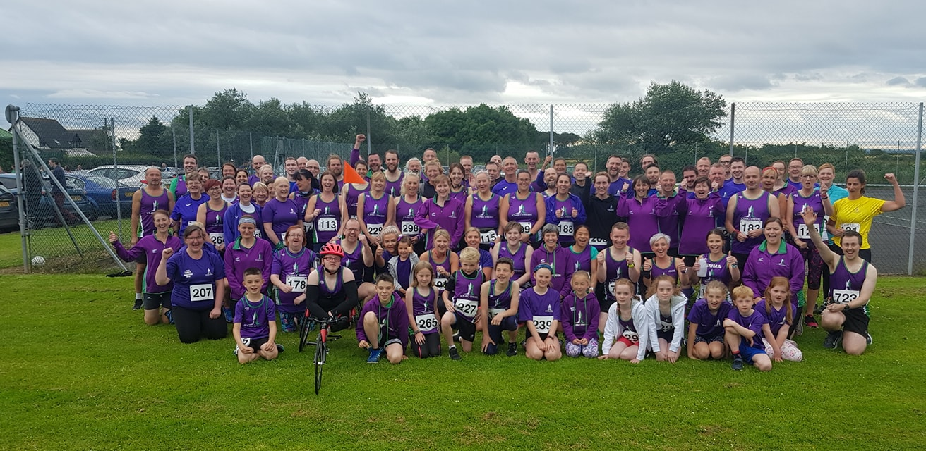 Heat and hills once again as Striders support a great charity.